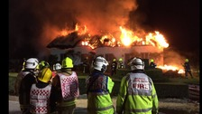 Fifty fire fighters and specialist crews tackle thatch fire