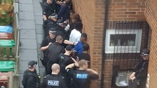 Police raid a property in Manchester