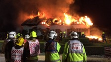 Fifty firefighters tackle huge fire at thatched cottage
