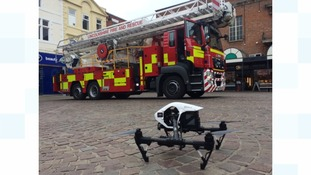 Drone helps firecrews in teenagers' rooftop rescue