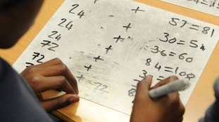 A child doing arithmetic, as teachers have said schools should consider refusing to take part in
