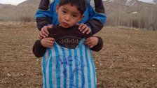 Boy who wore plastic Messi shirt flees Afghanistan