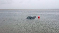 Car left stranded after being caught out by tide