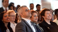 Labour's candidate for Mayor of London, Sadiq Khan, sits next to his wife Saadiya