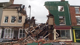 The building caved in following the fire on Sunday.