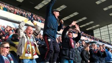 Burnley fans celebrate at Turf Moor following the club's promotion.