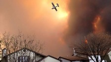 Residents flee as wildfire engulfs Canadian city