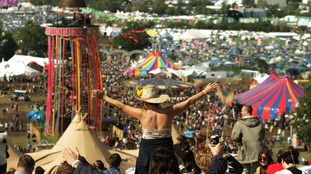 Revellers enjoying the sunshine at Glastonbury Festival