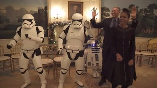 President Obama and First Lady dance with storm troopers on Star Wars Day