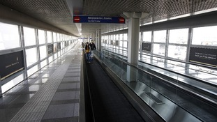 Passengers travel on an empty escalator in Athens.