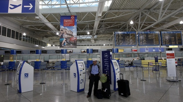 A man stands inside Athens' Eleftherios Venizelos airport during a 24-hour strike, which starts today.