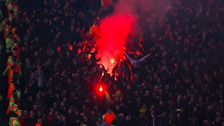 Liverpool fans let off a red flare in the stands during the UEFA Europa League match at Old Trafford, Manchester