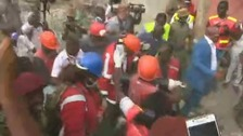 Woman pulled alive from rubble six days after collapse