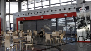 A cafe is closed inside one of Greece's busiest airports.