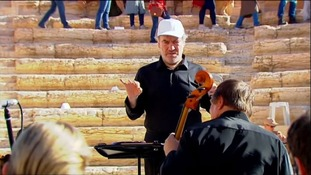 Russian conductor Valery Gergiev performs at Syria's Palmyra ruins