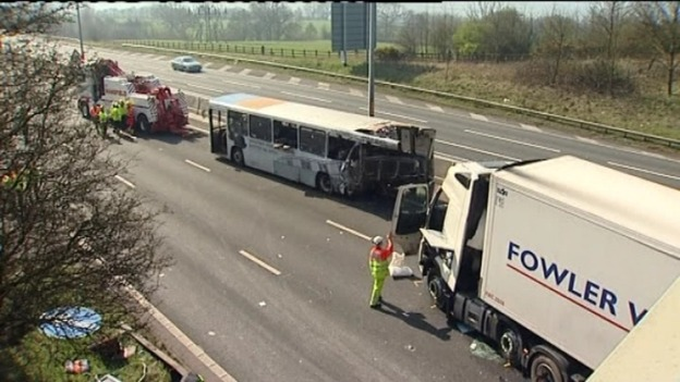 The lorry crashed into the bus which had broken down on a live carriageway