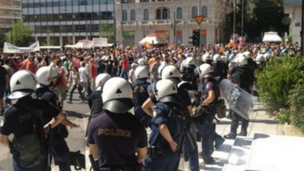 Riot police line the streets in the Greek capital.