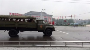 An army truck filled with soldiers passes the Congress venue