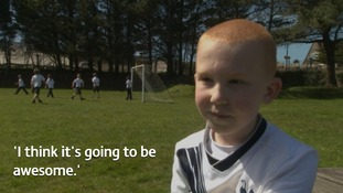 Little 'boy with the blades' trains with his footballing heroes