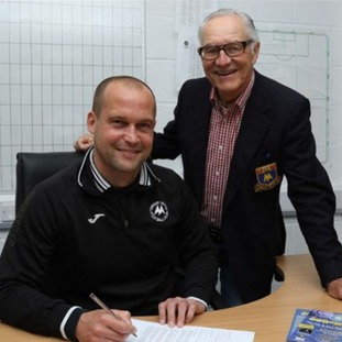 Kevin Nicholson signs 3 year contract to remain as player-manager.