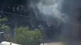 Police fire tear gas at anti-government Greeks.