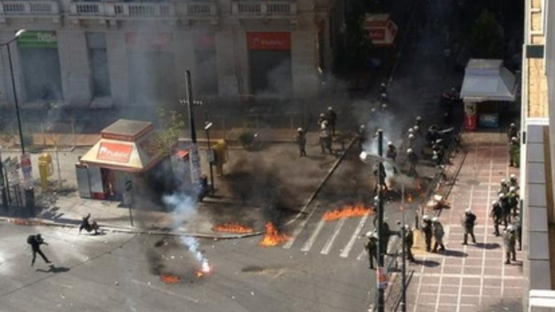 Protesters throw petrol bombs at riot police in Athens.