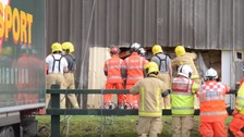 Person feared trapped under tons of cheese after warehouse collapse