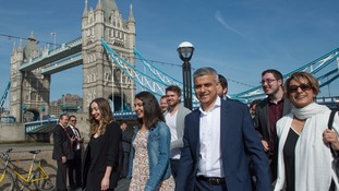 Sadiq Khan arrives at City Hall in London with his wife Saadiya (right) and campaign team