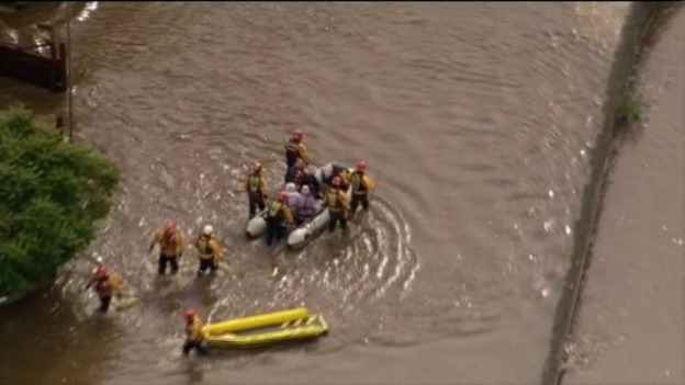 People are rescued from their flooded homes