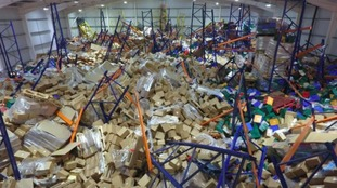 Tonnes of cheese collapsed onto a worker in the warehouse