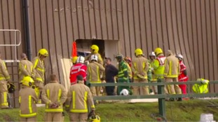 Fire crews cut open the side of the building to get the man out