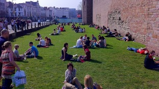 Sunbathers outside Cardiff Castle