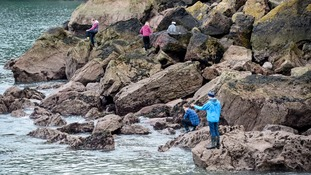 People searching for Rose Polge's body in Anstey's Cove, Torquay.