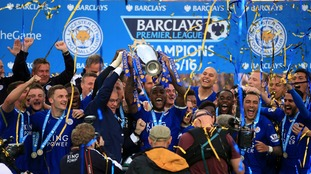 Leicester City lift the trophy.