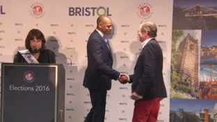 Marvin Rees shakes hands with predecessor George Ferguson.