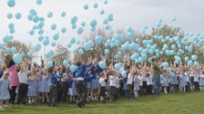 Balloons were released at a school in Dalston.