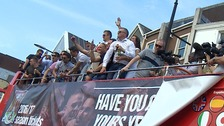 The club's players and staff take an open top bus parade from Sixfields stadium to the Guildhall.