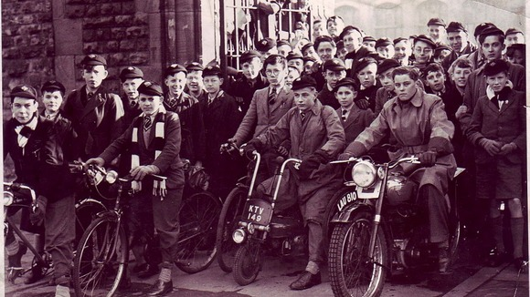 Boys on bikes – features in this photo are still there today, spilling out of Forest Road West entrance