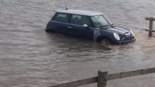 A Mini Cooper stranded at high tide.