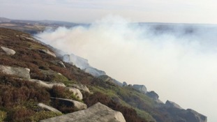 Firefighters withdraw from tackling moorland fire