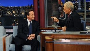 David Cameron talks with talk show host David Letterman on the David Letterman Show in New York,