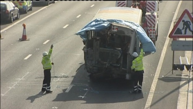 Recovery workers covering up the bus involved in this morning&#x27;s crash