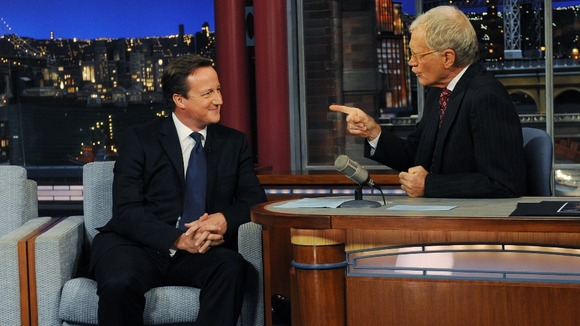 Prime Minister David Cameron (left) talks with talk show host David Letterman.