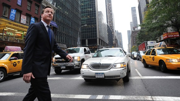 Prime Minister David Cameron walks through the streets of New York after addressing the UN General Assembly in New York yesterday.
