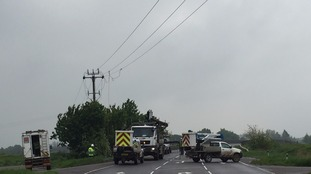 Engineers carrying out repairs on the A142 in Cambridgeshire after a crash brought down power lines