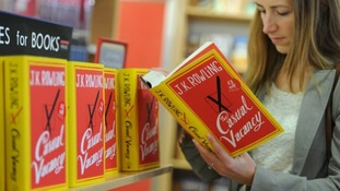 A customer reads JK Rowling's new novel.