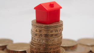 Model house on pound coins