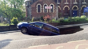Car falls into sinkhole on London street
