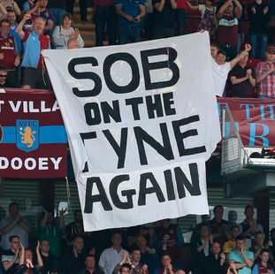 Aston Villa fans hold up banners in the stands during the Barclays Premier League match at Villa Park, Birmingham (7th May)