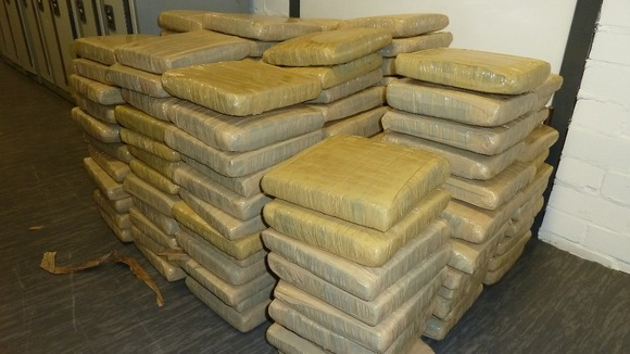 Just some of the hundreds of tape-wrapped packages containing cannabis.